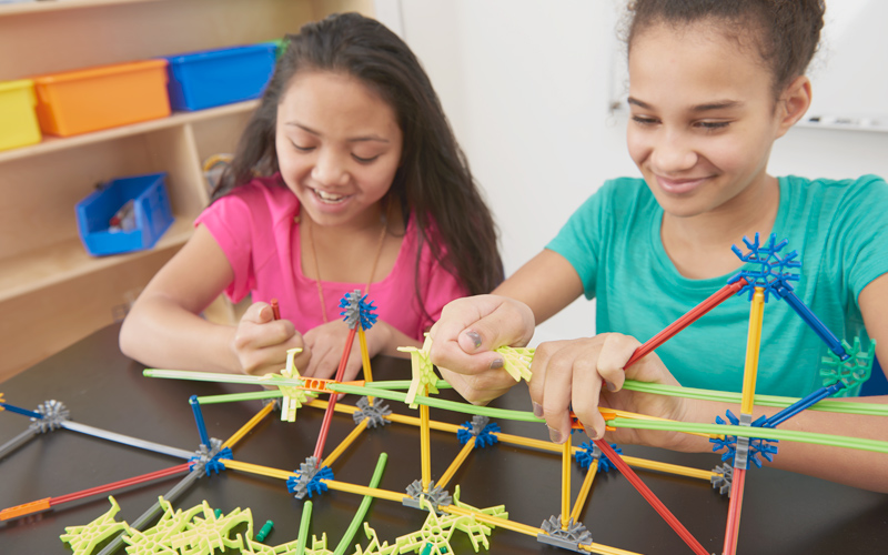 Kids building suspension bridge model