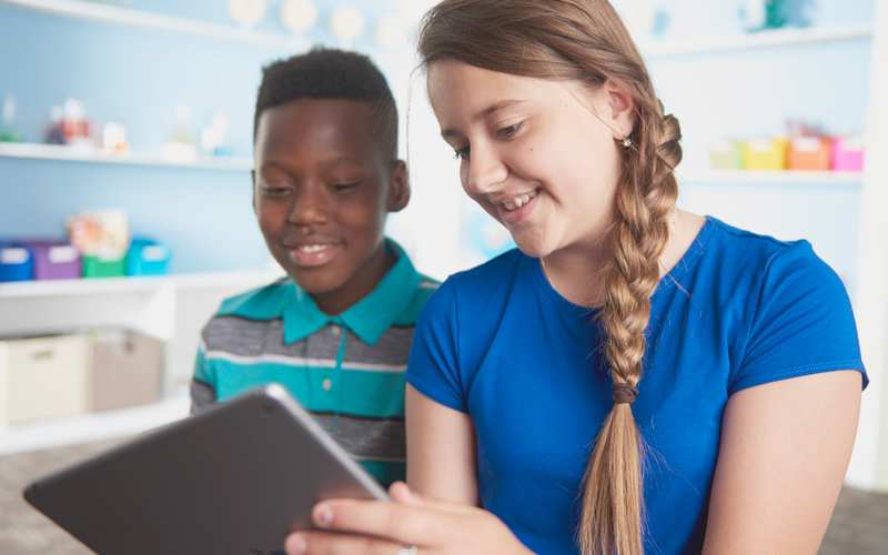 Kids reading data on tablet